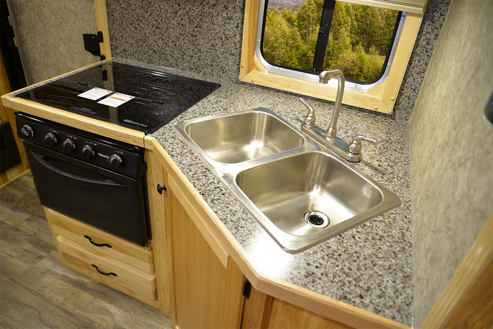 Kitchen in a Charger C8X11RK | Lakota Trailers