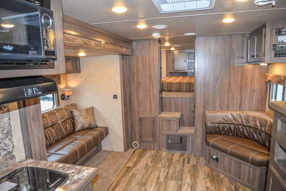 Living Area with a Corner Lounge in a C8X15CL - Charger Edition Horse Trailer | Lakota Horse Trailers