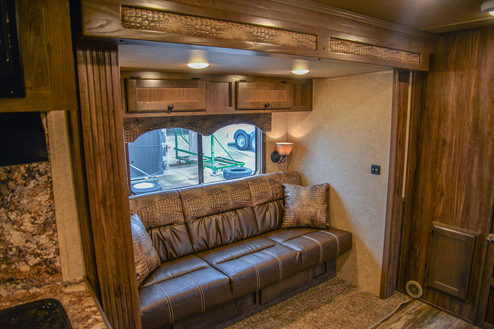 Sofa Bed in the slide of a C8X15CL - Charger Edition Horse Trailer | Lakota Horse Trailers