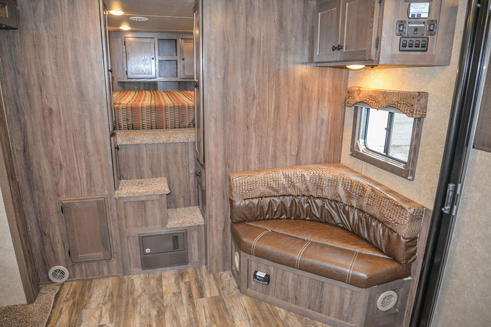 Corner Lounge and Steps to Bedding Area in a C8X15CL - Charger Edition Horse Trailer | Lakota Horse Trailers