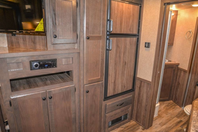 Kitchen Storage and Refrigerator in a C8X15CL - Charger Edition Horse Trailer | Lakota Horse Trailers