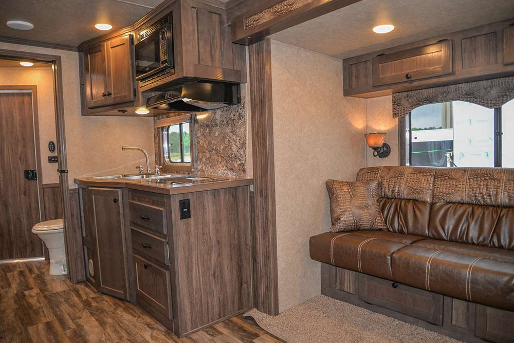 Sofa Bed and Kitchen in a C8X15CL - Charger Edition Horse Trailer | Lakota Horse Trailers