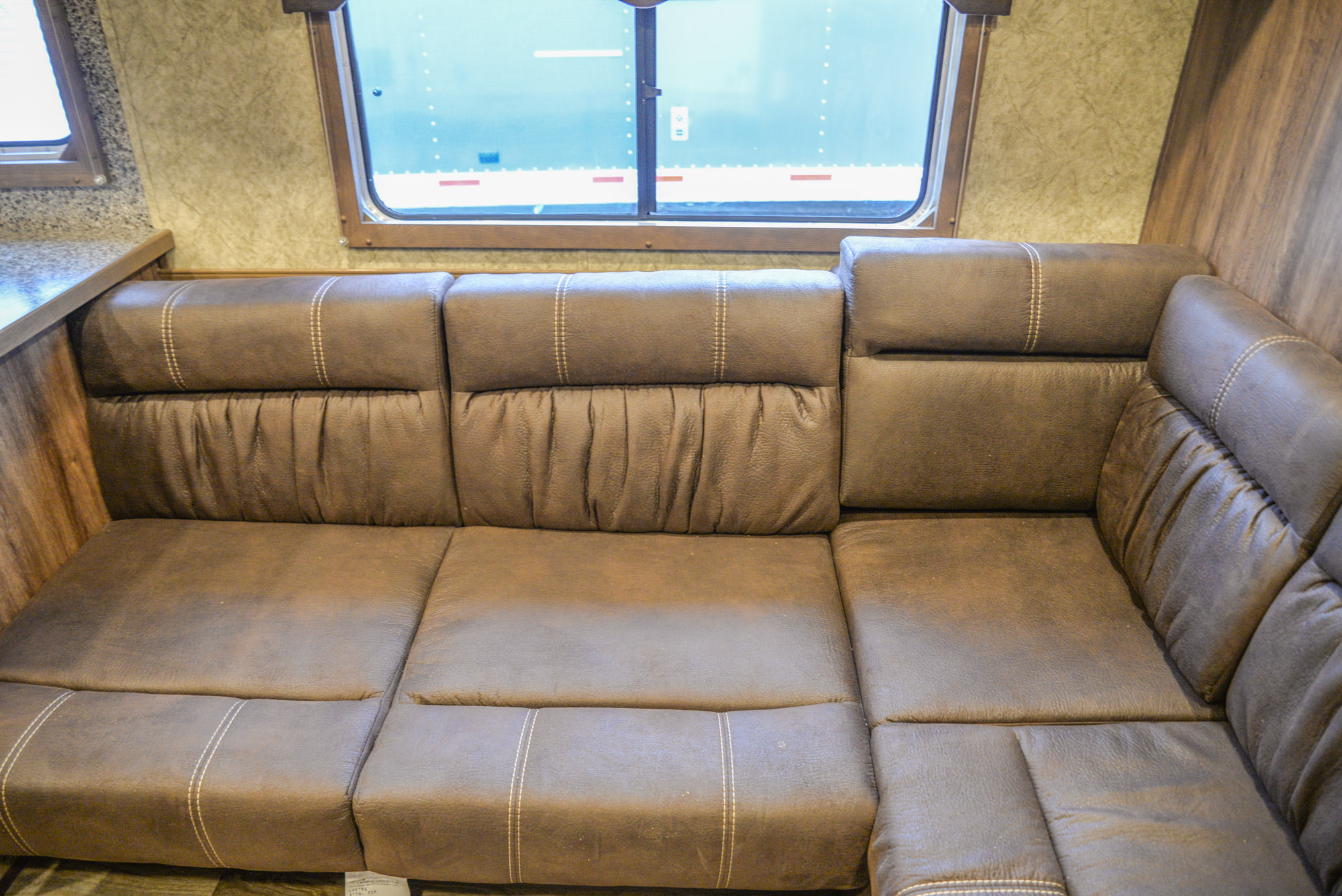 Sofa Bed in a C8X14LSR - Charger Edition Horse Trailer | Lakota Horse Trailers