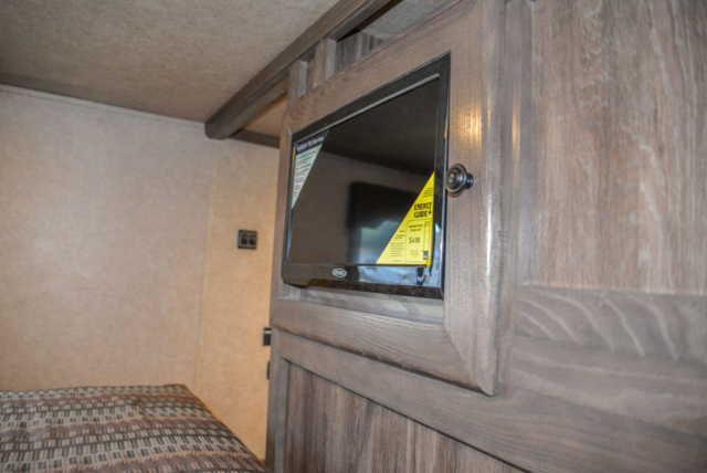 Bedroom TV in a C8X15CE - Charger Edition Horse Trailer | Lakota Horse Trailers