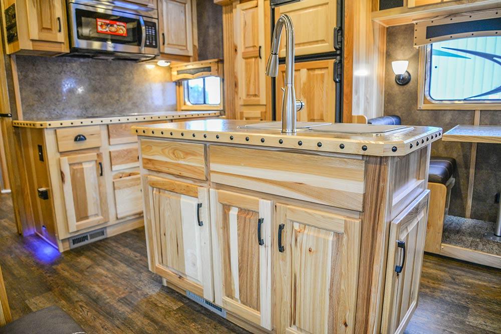 Island cabinets in a Bighorn BH8X192SI | Lakota Trailers