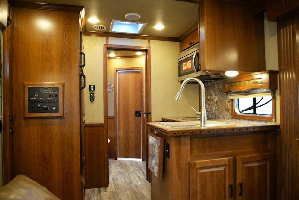 Kitchen in a Bighorn BH8X15DSRK | Lakota Trailers
