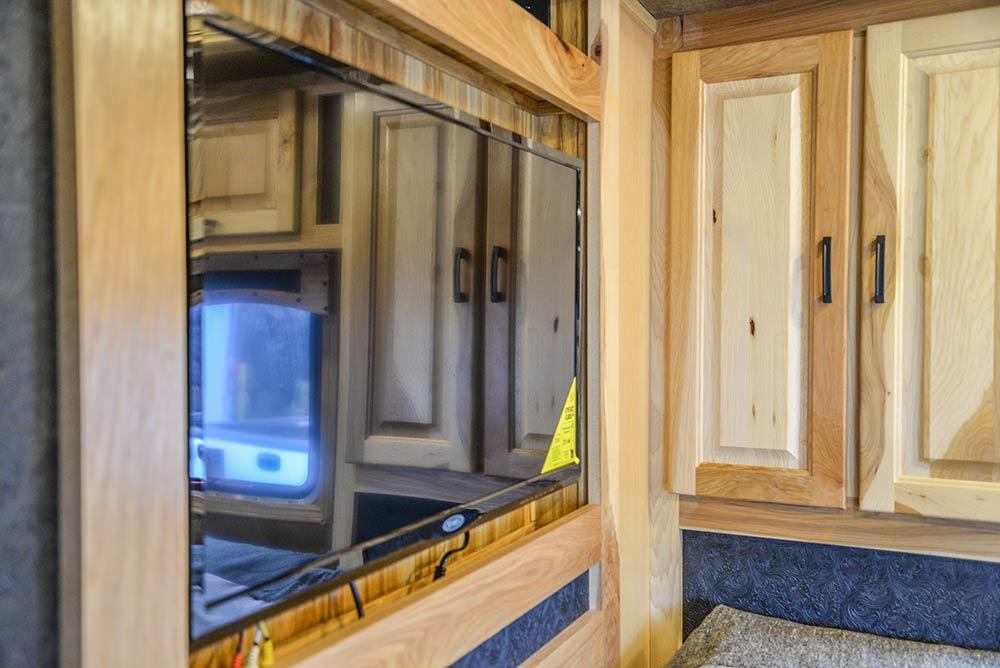 TV in bedroom in a Bighorn BH8X192SI | Lakota Trailers