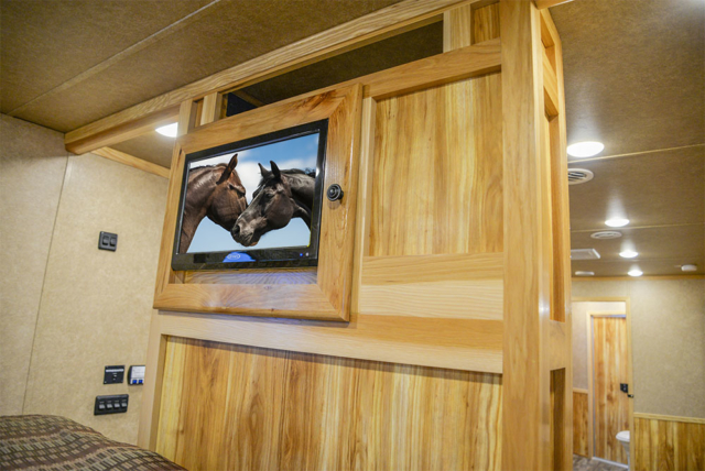 TV in Gooseneck/Bedding Area in a C8X18CE - Charger Edition Trailer | Lakota Trailers