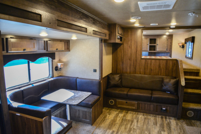 Sofa and dinette in Charger C8X15SOR9S | Lakota Trailers