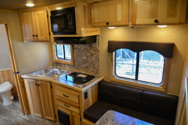 Kitchen and dinette in Charger C8X11DR | Lakota Trailers