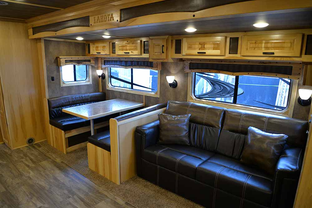 Dinette and sofa in BH8X19T2S Bighorn | Lakota Trailers