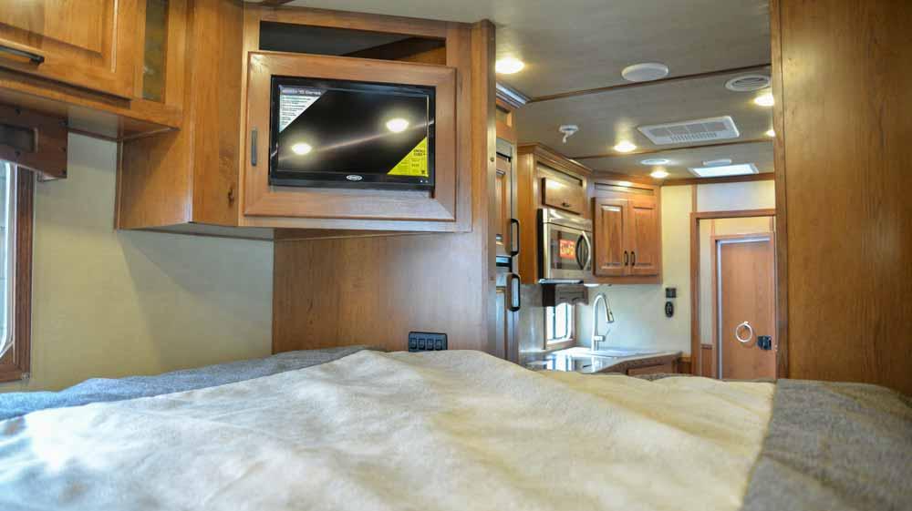 TV in bedroom in Bighorn BH8X11RK | Lakota Trailers