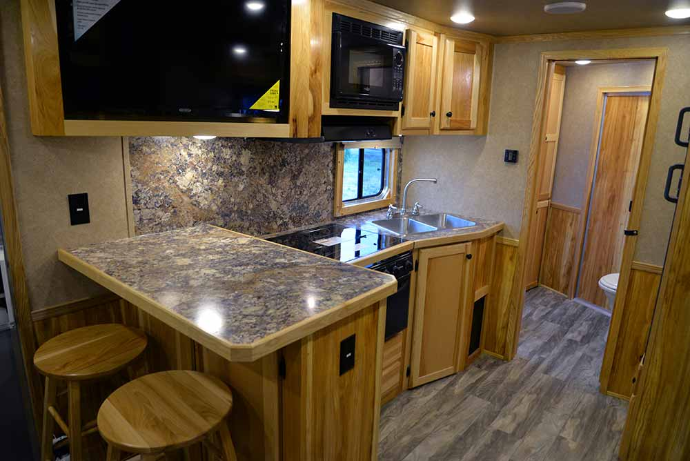 Kitchen and bar in Charger C8X15SRB | Lakota Trailers