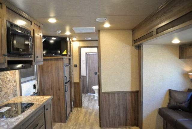 Living space in Charger C8X16BB |Lakota Trailers