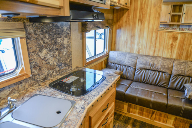 Living space in Charger C8X11SR | Lakota Trailers