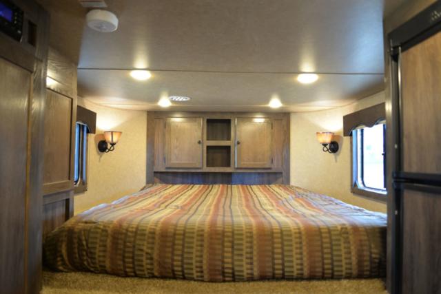 Bedroom in LE8X11SR Livestock | Lakota Trailers