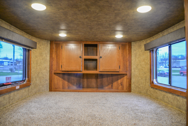 Bedroom in a AC311 Colt | Lakota Trailers