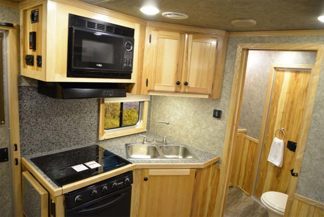 Kitchen and bathroom view in a Charger C8X11RK | Lakota Trailers