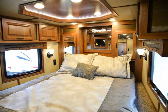 Bedroom in a Bighorn Livestock BLE8X16SR | Lakota Trailers
