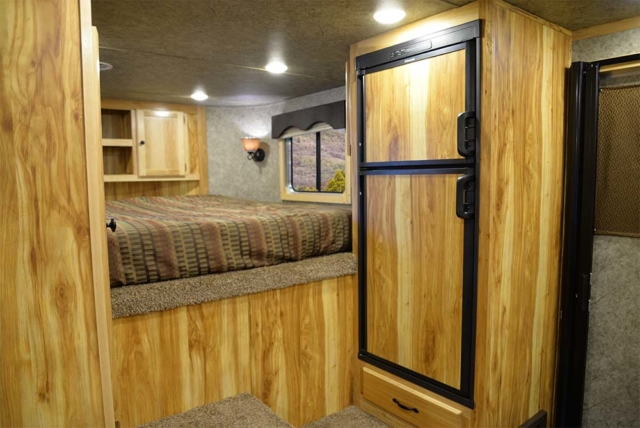 Living space in a Charger C8X11RK | Lakota Trailers