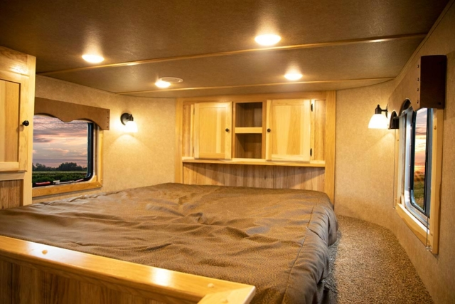 Bed in Gooseneck in LE8X11DR Charger Edition Livestock Trailer | Lakota Trailers