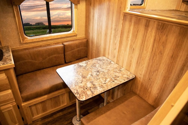 Dinette in LE8X11DR Charger Edition Livestock Trailer | Lakota Trailers