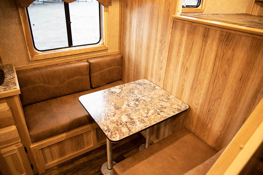 Dinette in a LE8X11DR Charger Edition Livestock Trailer | Lakota Trailers