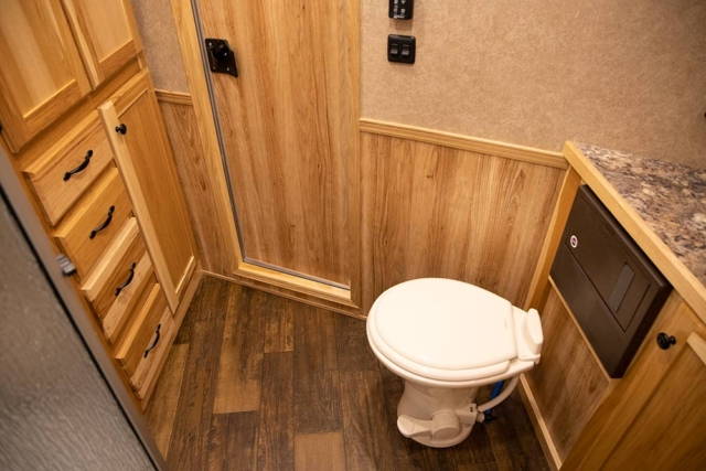 Bathroom Area in LE8X11DR Charger Edition Livestock Trailer | Lakota Trailers