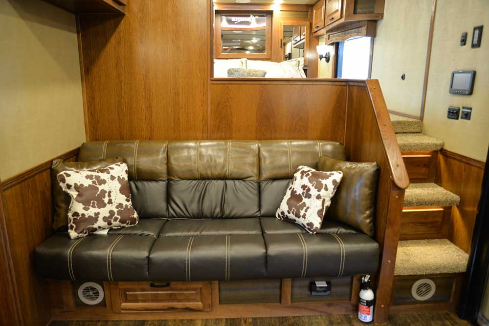 Sofa in a Bighorn Livestock BLE8X16SR | Lakota Trailers