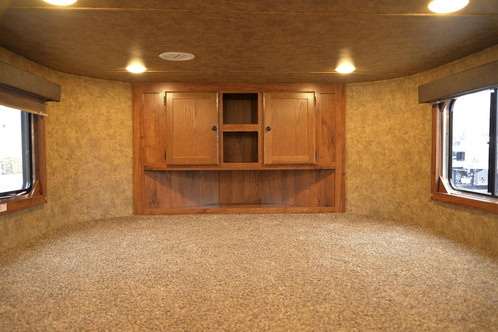 Bedroom in a Colt AC8311 | Lakota Trailers