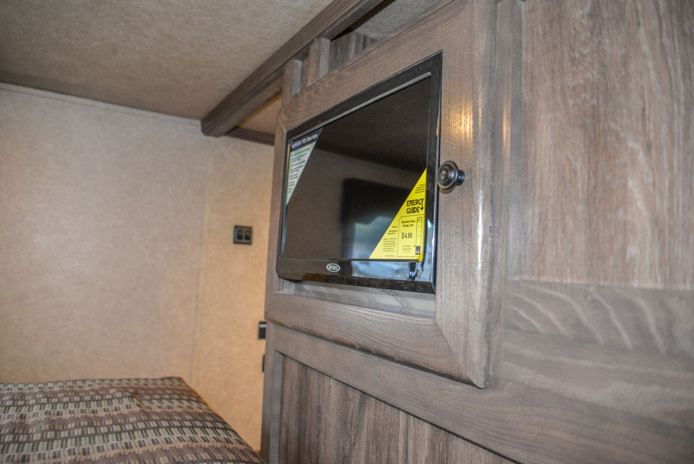 Bedroom TV in a Charger C8X14CE Horse Trailer | Lakota Trailers