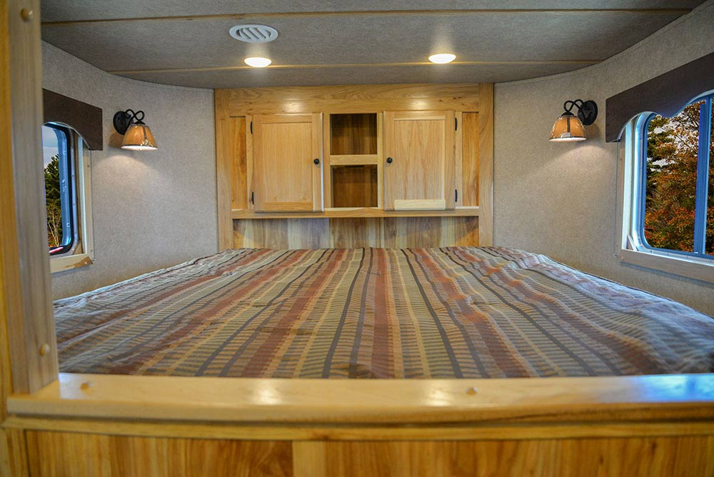 Bed in Gooseneck in LE8X13SR Charger Edition Livestock Trailer | Lakota Trailers