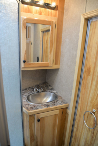 Bathroom in a LE8X13SR Charger Edition Livestock Trailer | Lakota Trailers