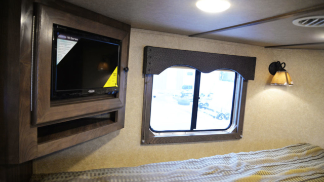 TV in Bedroom in Charger C8X15BB | Lakota Trailers