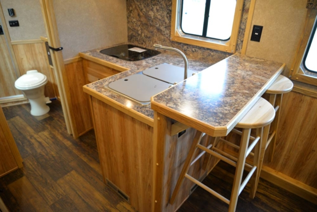 Rear kitchen in a C8X13SRB Charger Edition Horse Trailer | Lakota Trailers