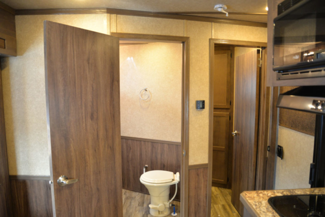 Bathroom and second bedroom entrance in Charger LE8X15BB | Lakota Trailers