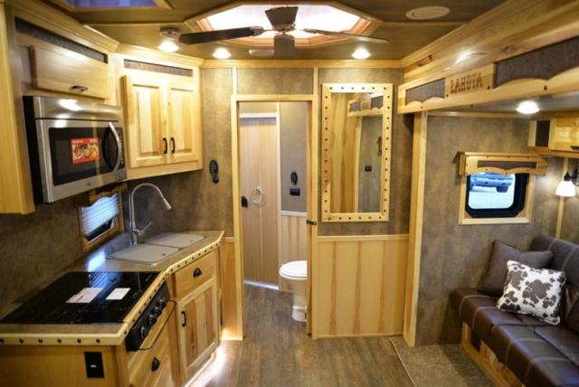 Living area in Custom BLE8X11RK Bighorn Livestock   Lakota Trailers