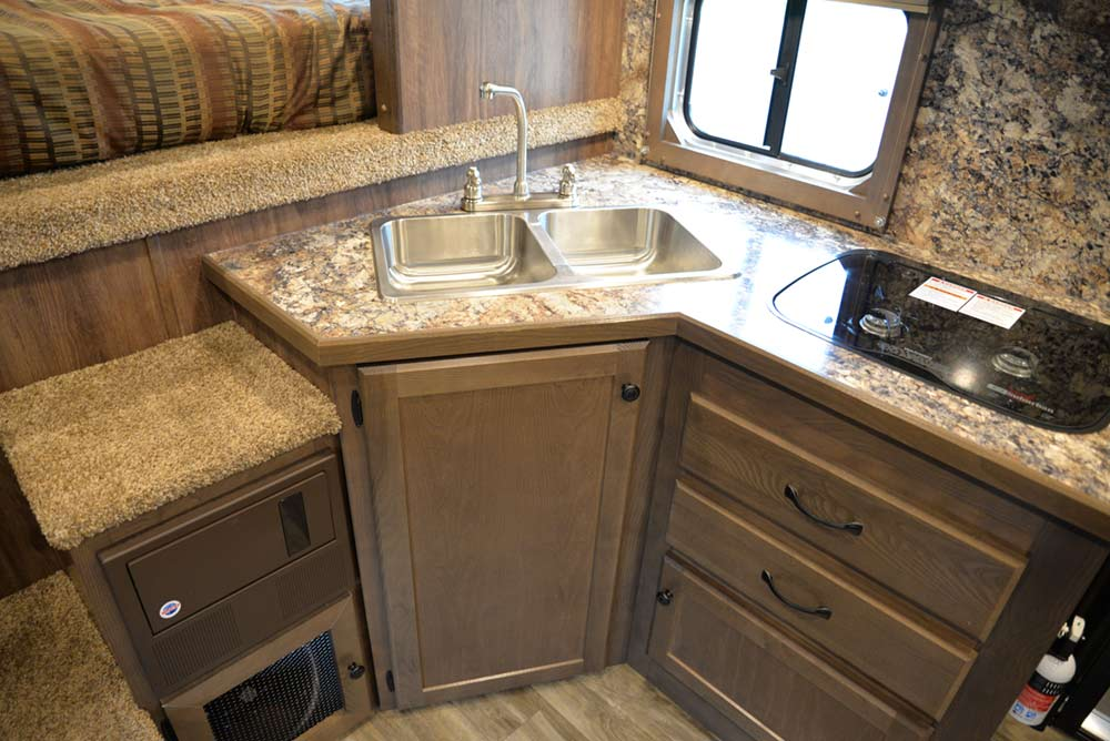 Kitchen Area in a LE8X11FK Charger Edition Livestock Trailer | Lakota Trailers