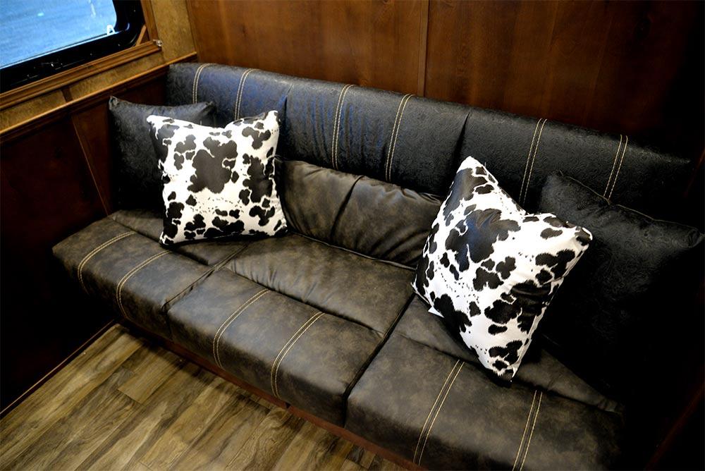 Sofa in a BH8X11SR Bighorn Edition Horse Trailer | Lakota Trailers