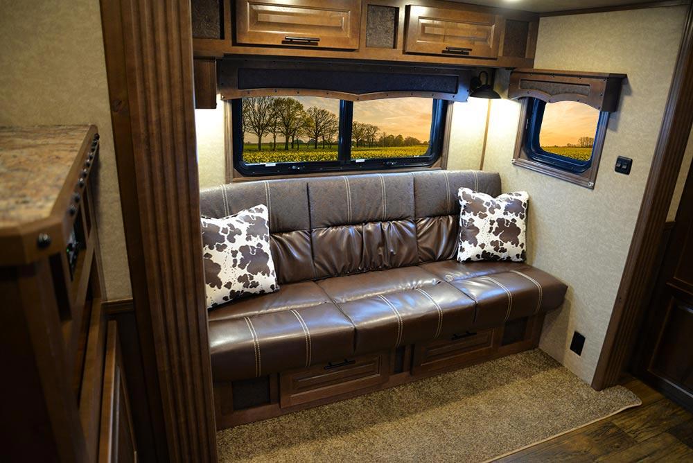 Sofa in a BH8X13RK Bighorn Edition Horse Trailer | Lakota Trailers