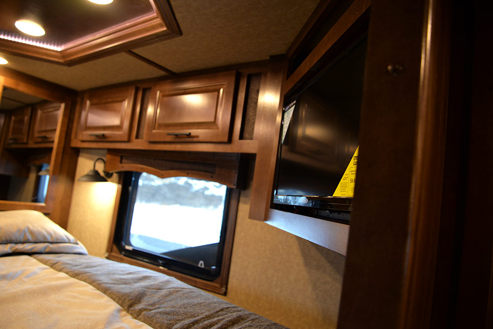 TV in Gooseneck of a BH8X13RK Bighorn Edition | Lakota Trailers