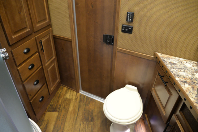 Bathroom Area in a BH8X13RK Bighorn Edition | Lakota Trailers
