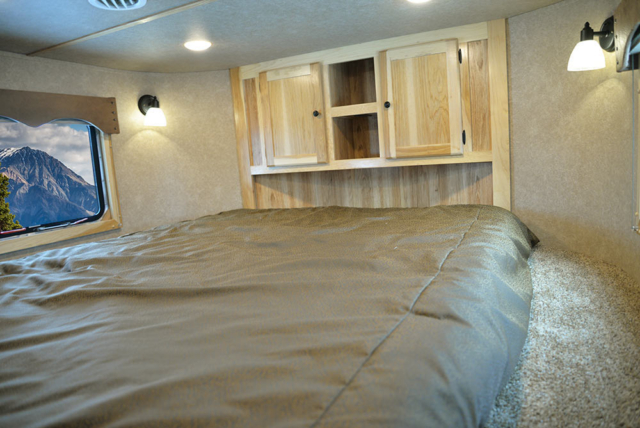 Bed in Gooseneck in LE8X14CE Charger Edition Livestock Trailer | Lakota Trailers
