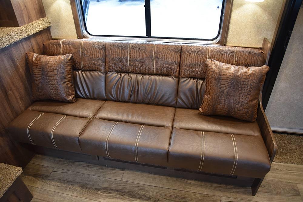 Sofa in LE8X15RKB Charger Edition Livestock Trailer | Lakota Trailers