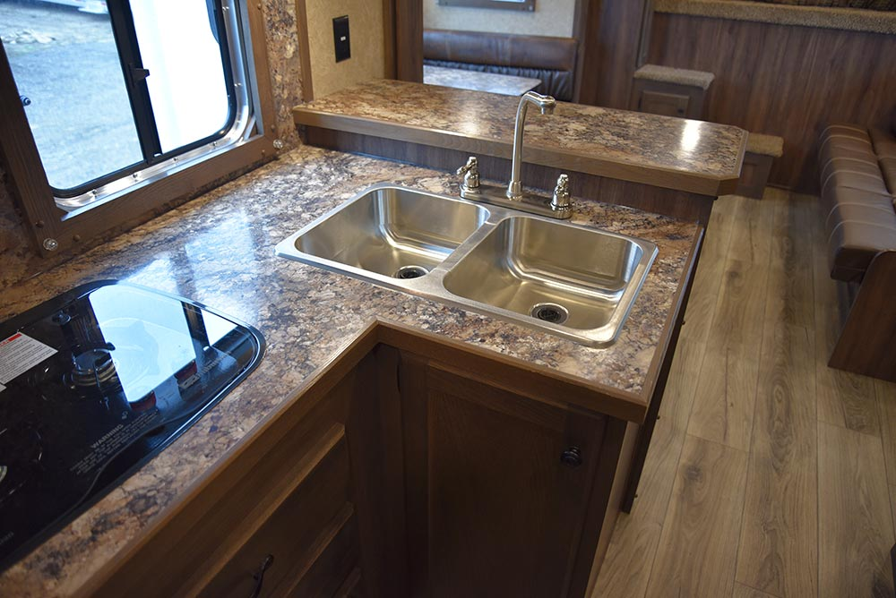 Kitchen Area in LE8X15RKB Charger Edition Livestock Trailer | Lakota Trailers