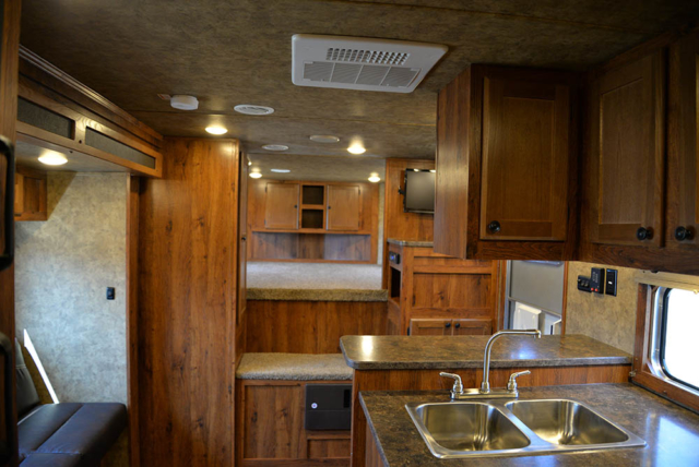Living area in a Colt AC8X13SO | Lakota Trailers