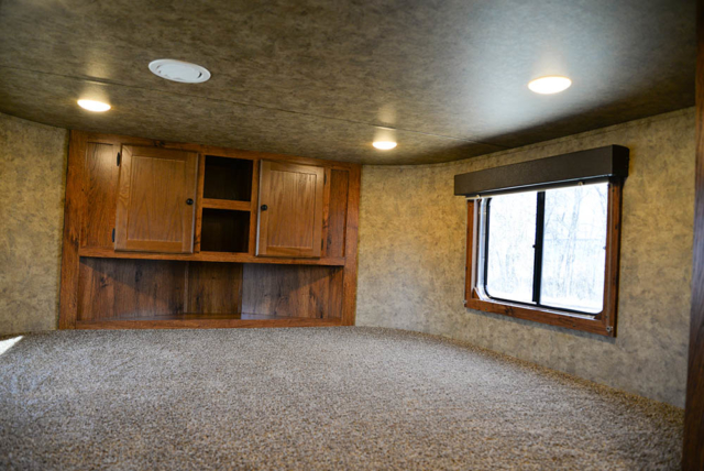 Bedroom area in a Colt AC8X13SO | Lakota Trailers