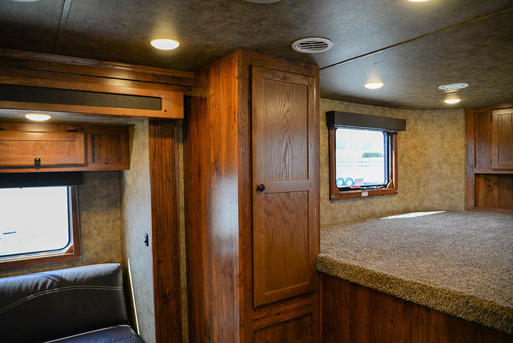Bedroom area in a Colt AC8X13SO   Lakota Trailers