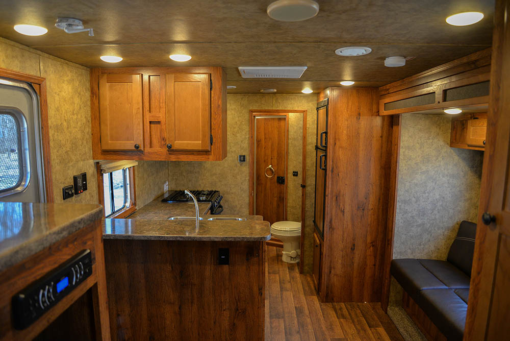 Living area in a Colt AC8X13SO   Lakota Trailers