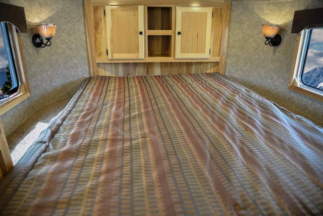 Bed in Gooseneck in LE8X11 Charger Edition Livestock Trailer | Lakota Trailers
